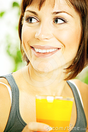 Healthy girl drinking orange juice