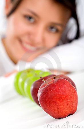 Healthy girl eating apples