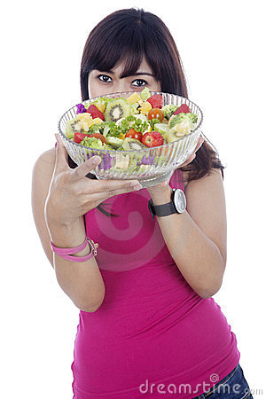 Healthy girl with salad
