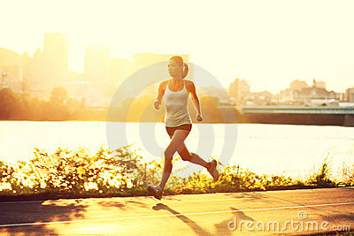 Healthy happy runner city running at sunset
