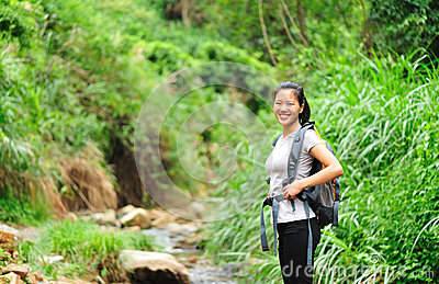 Healthy hiking asian woman