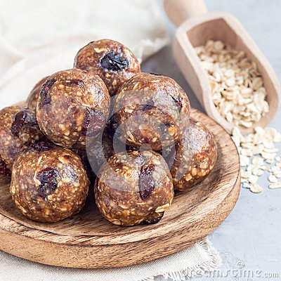 Free Healthy Homemade Energy Balls With Cranberries, Nuts, Dates And Rolled Oats On A Wooden Plate, Square Format Stock Photo - 108719520