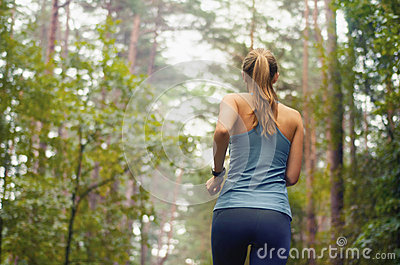 Healthy lifestyle fitness sporty woman running early in the morn