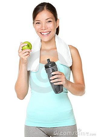 Healthy lifestyle - fitness woman eating apple