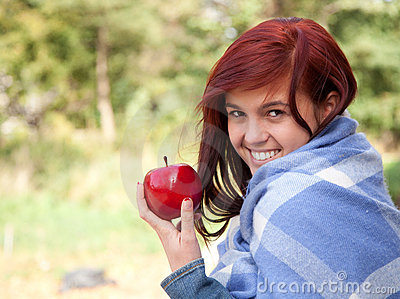 Healthy lifestyle - girl with apple