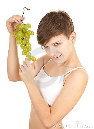 Healthy lifestyle - girl in sport bra with grapes