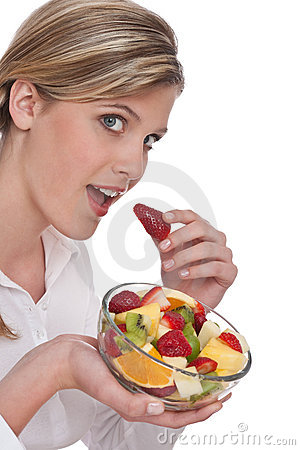 Healthy lifestyle series - Woman biting strawberry