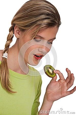 Healthy lifestyle series - Woman holding kiwi