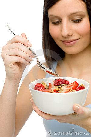 Healthy lifestyle - woman eat strawberry cereal