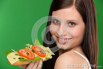 Healthy lifestyle - woman enjoy cheese sandwich