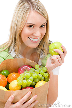 Healthy lifestyle - woman with fruit in paper bag