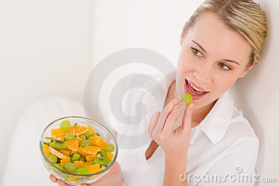 Healthy lifestyle - woman holding fruit salad