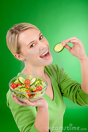 Healthy lifestyle - woman holding vegetable salad