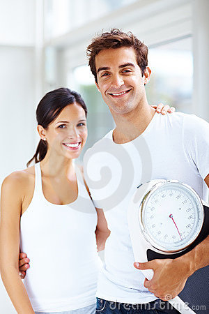 Healthy lifestyle - Young fit couple smiling