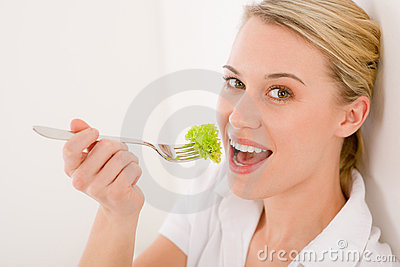 Healthy lifestyle - young woman with lettuce