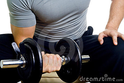 Healthy man hard workout in gym