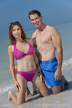 Healthy Middle Aged Couple in Swimsuits on A Beach