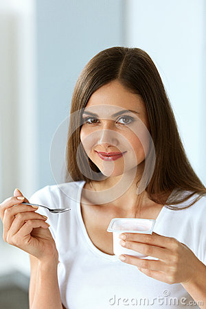 Free Healthy Nutrition. Beautiful Woman On Diet Eating Natural Yogurt Stock Photos - 79971843