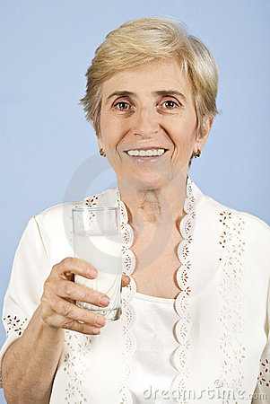Healthy old woman drinking milk
