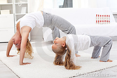 Healthy people doing gymnastic exercises at home