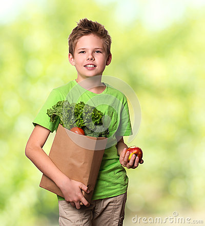 Free Healthy Positive Happy Child With Paper Shopping Bag Full Of Fre Royalty Free Stock Images - 81755229