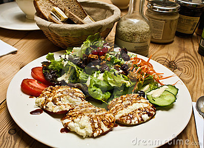 Healthy salad and bread on wood table