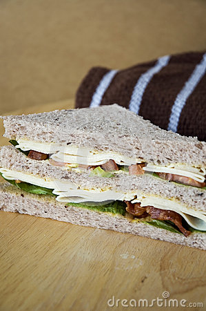 Healthy sandwich on wooden table