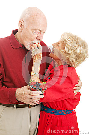 Healthy Senior Couple Eating Berries