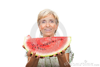 Healthy senior woman holding watermelon