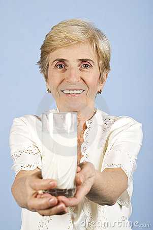 Healthy senior woman with milk glass