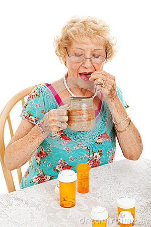 Free Healthy Senior Woman Takes Medication Stock Images - 27538024