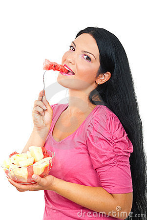 Healthy smiling woman eating watermelon