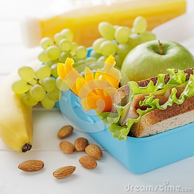 Free Healthy Snack In Blue Plastic Lunch Box On White Wooden Table. Stock Photography - 100838312
