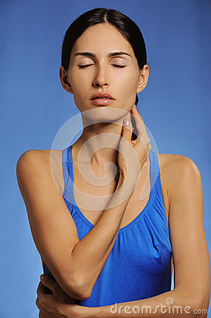 Healthy sport woman massages her neck preventing pain