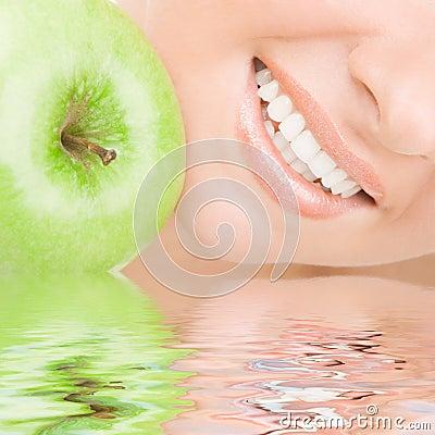 Healthy teeth and apple