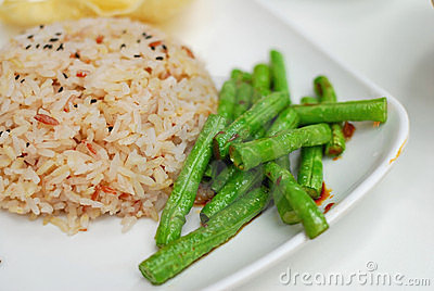 Healthy unpolished red rice and beans