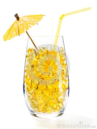 Healthy vitamin cocktail: pills in glass