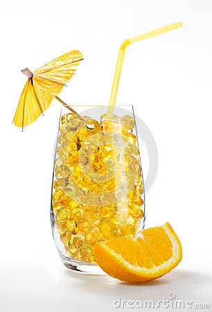Healthy vitamin cocktail: yellow pills in glass