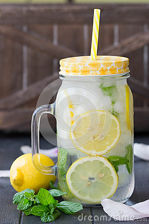 Free Healthy Water With Mint, Sliced Lemons And Cucumbers. Diet Drink. Sassy Water. Mason Jar Full With Sliced Fruits And Vegetables. Royalty Free Stock Images - 92692129