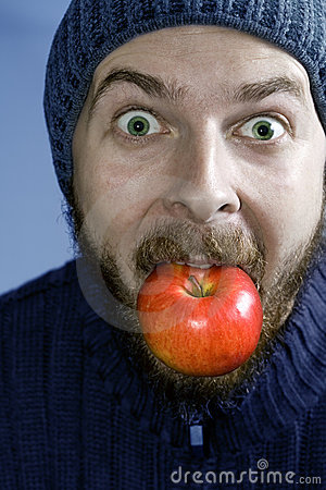 Healthy winter nutrition concept - man and apple