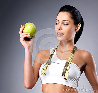 Healthy woman with apple and bottle of water