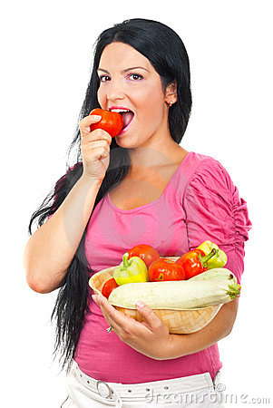 Healthy woman biting a tomato