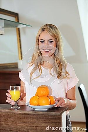 Healthy woman drinking fresh orange juice