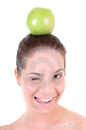 Healthy woman with green apple winking