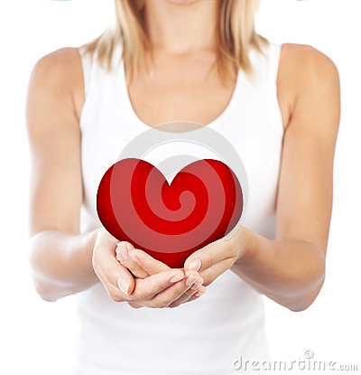 Healthy woman holding heart, selective focus