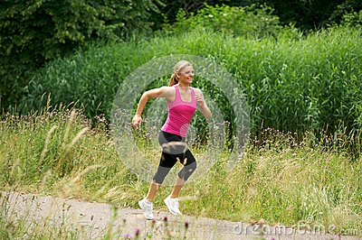 Healthy woman jogging in the park on a summer day