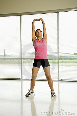 Healthy woman stretching.
