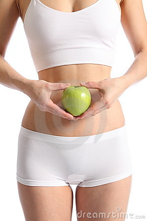 Healthy womans body white underwear holding apple
