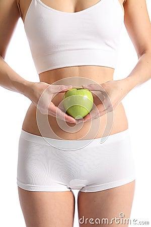 Healthy womans body white underwear holding apple