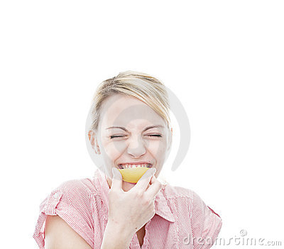 Healthy young blonde attractive woman with lemon